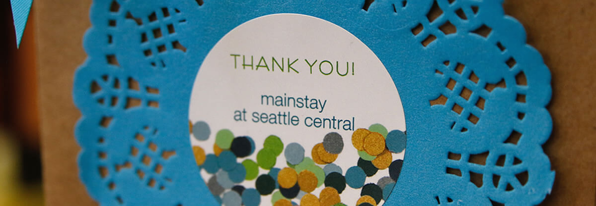 Up close of Mainstay thank you card at donor event